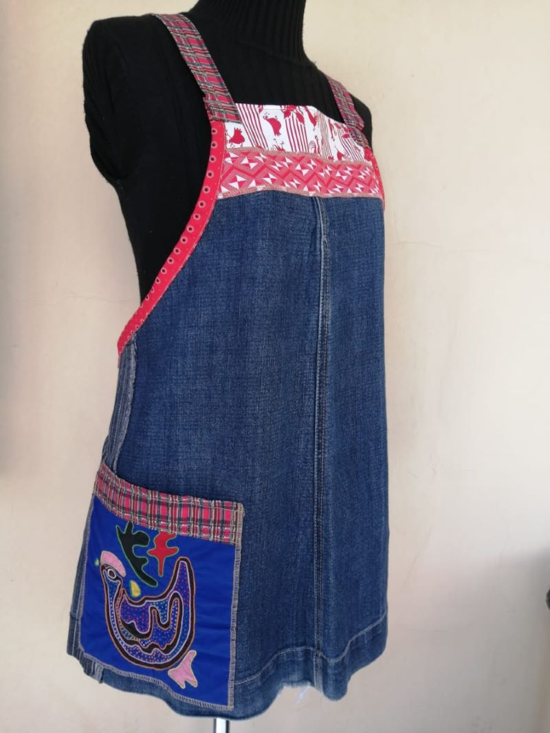 Denim apron with pink edging and fowl motif on large pocket