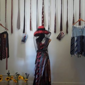 Dress and Skirts made from Upcycled Men's Ties on display in Heart's on Main