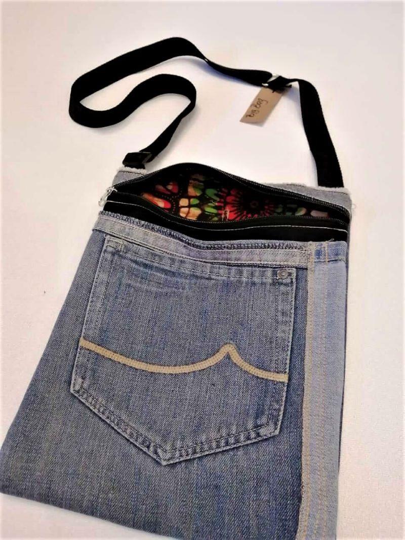 Denim sling bag with colourful inner