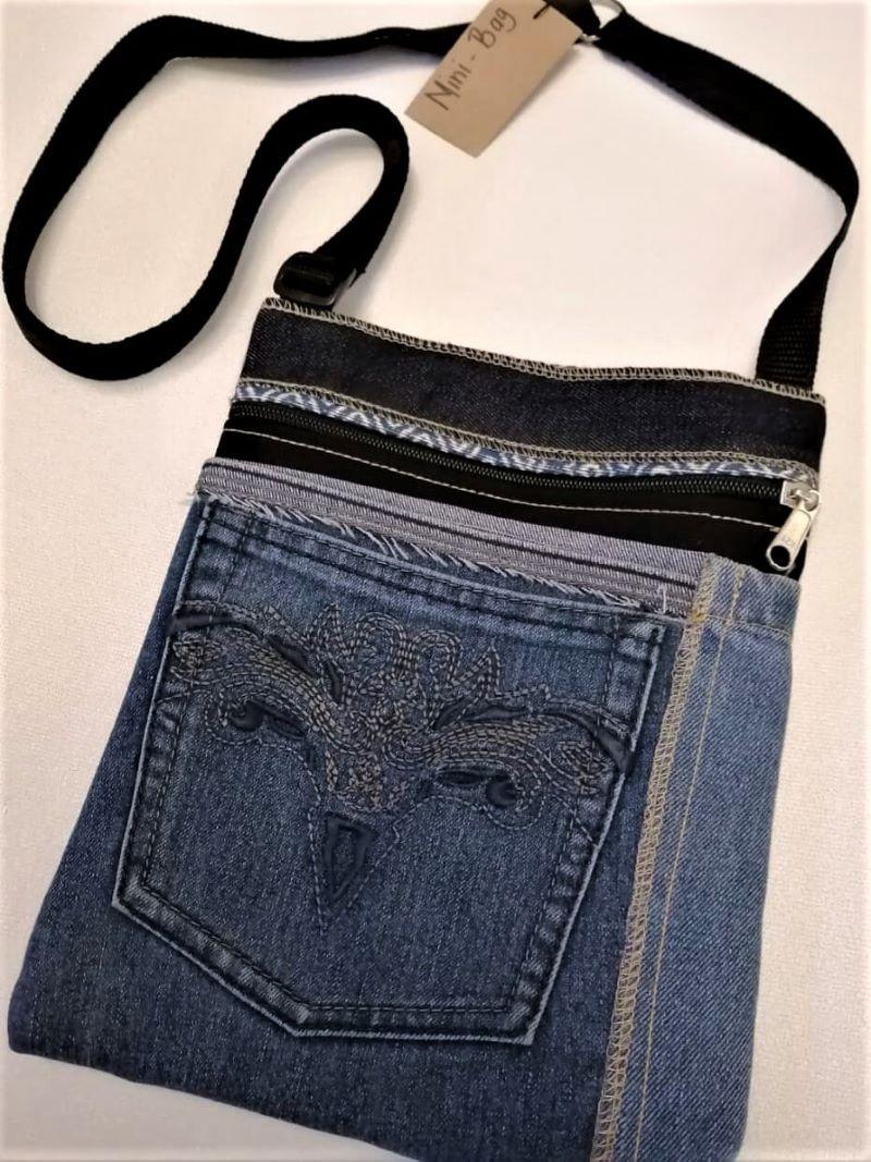 Denim sling bag with stitch detail on pocket