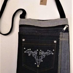 Dark denim sling bag with studs on pocket