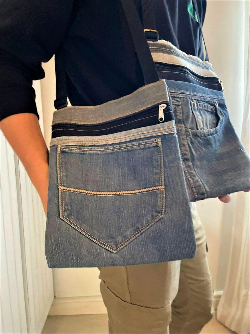 man carrying denim sling bag