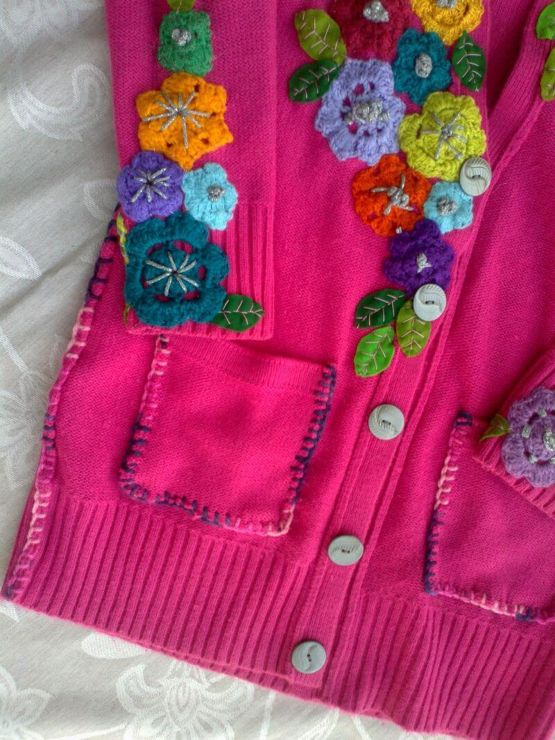 Close-up of the lovely upcycled pink jersey showing the beautiful flowers and stitching detail