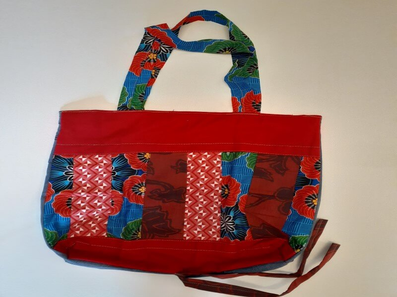 Rich red spacious upcycled material shopping bag with poppy and geometric detail