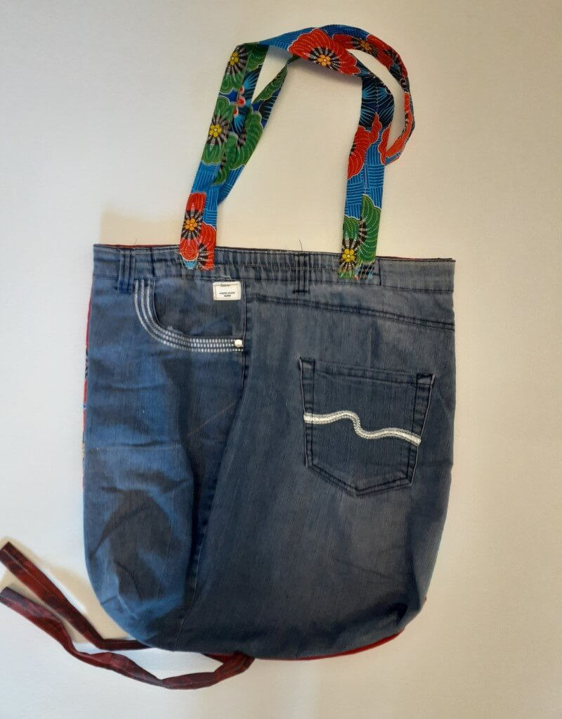 Large upcycled denim shopping bag with pockets and colourful sling handle