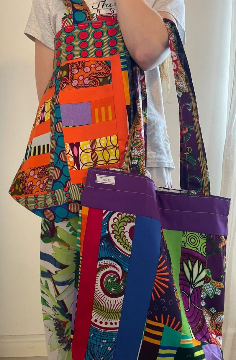 Range of large bright and colourful upcycled material shopping bags